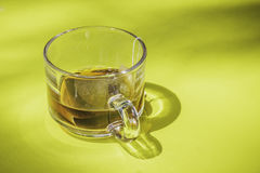 Closeup of teabag on cup. Closeup of teabag on cup on the table Stock Image