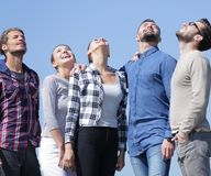 Closeup.a team of young people looks up. Isolated on a blue background Royalty Free Stock Image