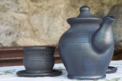 Closeup of teapot and teacup royalty free stock photography
