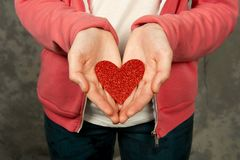 Closeup of teen girl  holding red heart Stock Images