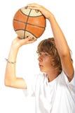Closeup of teen throwing basketball. Closeup of teen boy throwing basketball isolated on white background Stock Image
