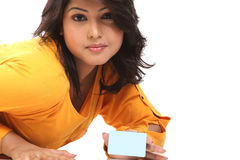 Closeup of Teenage girl  with blue credit. Closeup of Beautiful Teenage  girl lying on floor with blue credit card Stock Image