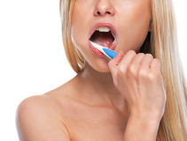 Closeup on teenage girl brushing teeth Royalty Free Stock Images