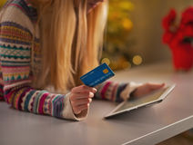 Closeup on teenage girl with credit card using tablet pc Stock Image