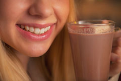 Closeup on teenage girl drinking cup of hot chocolate Royalty Free Stock Images
