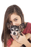 Closeup of teenage girl holding a cute chihuahua dog Stock Photography