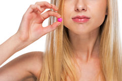 Closeup on teenage girl showing pill Royalty Free Stock Image