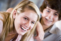 Closeup of teenage girl smiling with brother stock photo