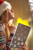 Closeup on teenager girl holding notepad Stock Photography