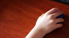 Closeup of teenager hand using a computer mouse stock video