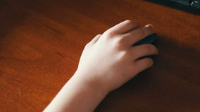 Closeup of teenager hand using a computer mouse stock video footage