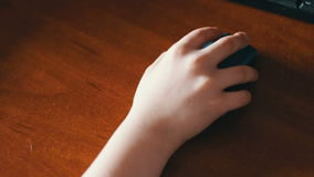 Closeup of teenager hand using a computer mouse stock footage