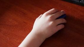 Closeup of teenager hand using a computer mouse. Wireless computer mouse which uses child teenager stock footage