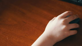 Closeup of teenager hand using a computer mouse. Wireless computer mouse which uses child teenager stock video footage