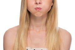 Closeup on teenager holding breath. Closeup on teenager girl holding breath Royalty Free Stock Photography
