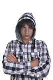 Closeup of a teenager wearing a hoodie, underlit. On white background Royalty Free Stock Images