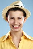 Closeup  teenager wears hat and yellow shirt Royalty Free Stock Photography