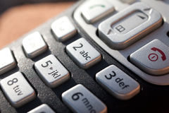 Closeup of a telephone keypad in direct sunlight Stock Image