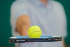 Closeup tennis ball balancing on racket Royalty Free Stock Photo