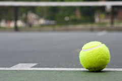 Closeup of tennis ball on base line Royalty Free Stock Image