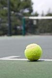 Closeup of tennis ball on base line Royalty Free Stock Photography
