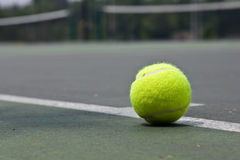 Closeup of tennis ball on base line Royalty Free Stock Photos