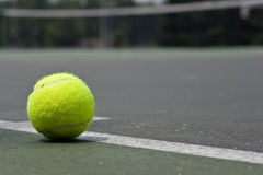 Closeup of tennis ball on base line Royalty Free Stock Images