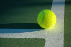 Closeup of Tennis Ball on court Royalty Free Stock Image