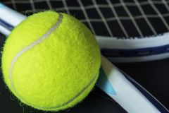 Closeup of tennis ball with racket Royalty Free Stock Photography