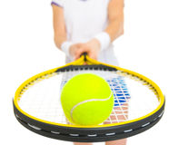 Closeup on tennis ball on racket in hand of female Royalty Free Stock Images