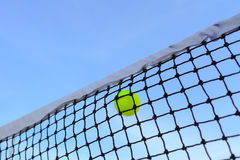 Closeup tennis net and ball Stock Photography