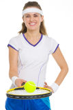 Closeup on tennis player balancing ball on racket Stock Photography
