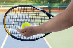 Closeup tennis player preparing to serve Royalty Free Stock Photography