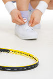 Closeup on tennis player tying shoelaces Stock Photos