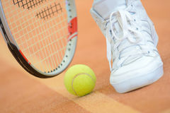 Closeup tennis racket ball and shoe Royalty Free Stock Images