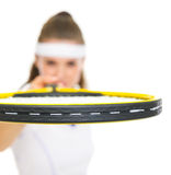 Closeup on tennis racket in hand of woman Stock Images