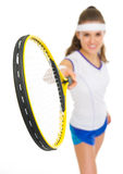 Closeup on tennis racket in hand of woman Royalty Free Stock Photo