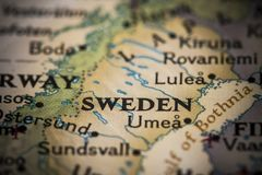 Sweden on map. Closeup of the text `Sweden` on a world map Royalty Free Stock Image