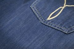 Closeup texture of back pocket blue denim jeans royalty free stock photography