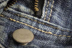The closeup of texture background  jean, zipper and button Stock Image