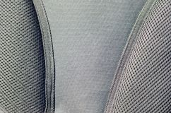 closeup of texture breathable mesh fabric in the black photo backpack. Texture of Black Plastic Weave Bag. Background imag Royalty Free Stock Image