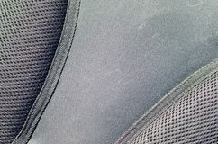 Closeup of texture breathable mesh fabric in the black photo backpack. Texture of Black Plastic Weave Bag. Background imag. E stock photos