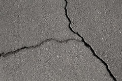 Closeup texture of damaged asphalt road Royalty Free Stock Photography