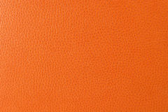 Closeup texture of orange imitation leather Royalty Free Stock Images