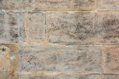 Closeup texture of plaster wall with huge bricks stock photo