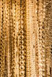 Gold beads and crystals on strings Stock Photography