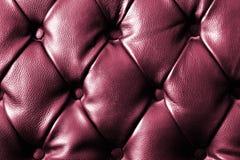 Closeup texture of vintage black leather sofa Stock Photos