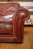 Closeup texture of vintage brown leather armchair in  library Royalty Free Stock Photo