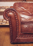 Closeup texture of vintage brown leather armchair in  library Stock Photography