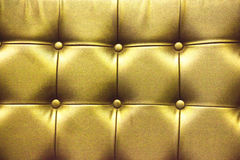 Closeup texture of vintage gold leather sofa for background Stock Photo
